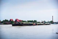 Tugboat cargo ship in Chao Phraya river. Stock Photo