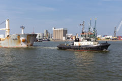 Tugboat with cargo ship in the harbor of Antwerp, Belgium Royalty Free Stock Image
