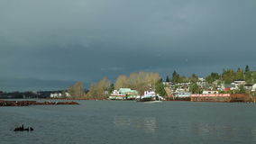 Tugboat and Clouds, Fraser River. A tug boat travels up the North Arm of the Fraser River. Vancouver, British Columbia, Canada stock footage