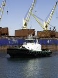 Tugboat and Cranes Stock Photo