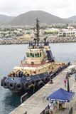 Tugboat at Cruise Ship Pier royalty free stock images