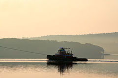 Tugboat in the early morning light Stock Photo