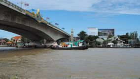 A tugboat goes up Chao Phraya River stock video