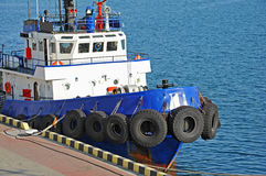 Tugboat in harbor quayside Royalty Free Stock Photo