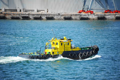 Tugboat in harbor quayside Royalty Free Stock Image