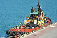 Tugboat in harbor quayside Stock Image