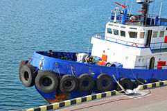 Tugboat in harbor quayside Royalty Free Stock Images