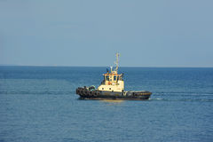 Tugboat in harbor quayside Stock Photography