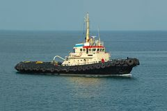 Tugboat in harbor quayside Royalty Free Stock Photos