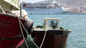 Tugboat in a Harbour. TURKEY - JULY 27, 2013: Tugboat moored in Kusadasi seaport. TURKEY. July 27, 2013n stock footage