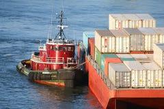 Tugboat hauling cargo ship Royalty Free Stock Photo