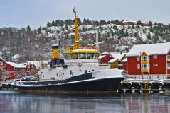 Tugboat in ice and snow. Royalty Free Stock Photo