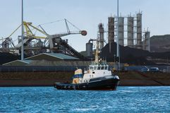Tugboat and industry. In the harbor Stock Photos