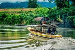 Tugboat on Kwai Noi River,Kanchanaburi,Thailand. Kwai Noi or Kwai Sai Yok is a river in western Thailand. It rises to the east of the Salween in the north-south stock image