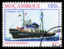 Tugboat Macuti , Ships of Mozambique serie, circa 1981. MOSCOW, RUSSIA - OCTOBER 6, 2018: A stamp printed in Mozambique shows Tugboat Macuti , Ships of royalty free stock images