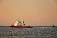 Tugboat in the Mediterranean. Tugboat plying near the port of Mandraki. Rhodes, Greece Stock Image