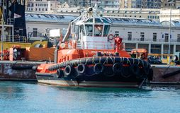 Tugboat moored in the port of Genoa, Italy stock photo