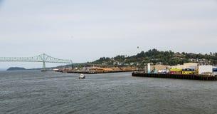 Tugboat Near Astoria Bridge and Lumber Mill. Operation Royalty Free Stock Image