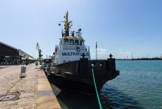 Tugboat near the pier in the seaport of Bourgas. Stock Photos