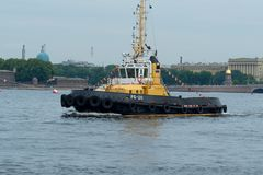 SAINT-PETERSBURG, RUSSIA - JULY 23, 2017: Tugboat on the Neva River. Rehearsal of the Naval Parade in St. Petersburg Royalty Free Stock Image