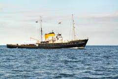 Tugboat and passenger ship sailing on Wadden Sea, Netherlands. Seagoing tug boat and passenger ship Holland cruising on Waddensea, Netherlands Stock Photos