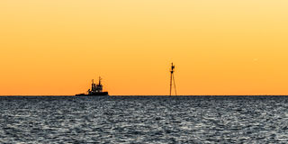 Tugboat. Picture of a tugboat in the horizon during sunset Royalty Free Stock Image