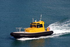 Tugboat Pilot Boat One. Pilot boat under way in beautiful blue ocean Royalty Free Stock Photos