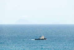 Tugboat Plows across the Caribbean Sea. A tugboat plows across the Caribbean Sea in the Dutch Antilles Royalty Free Stock Photography