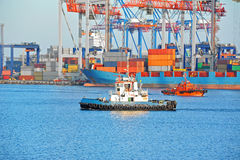 Tugboat and port cargo crane Royalty Free Stock Image