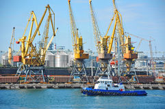 Tugboat and port cargo crane Royalty Free Stock Photo