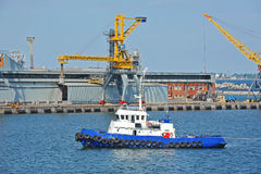 Tugboat and port cargo crane Royalty Free Stock Photography