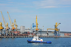 Tugboat and port cargo crane Stock Photography