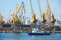 Tugboat and port cargo crane Stock Image