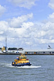 Tugboat in Port of Rotterdam. Stock Photography