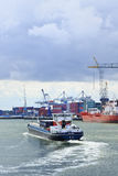 Tugboat in Port of Rotterdam. Stock Photos