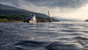Tugboat pulling a barge with coal Royalty Free Stock Photo