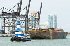 Tugboat pulling a barge in the Port of Miami Royalty Free Stock Photography