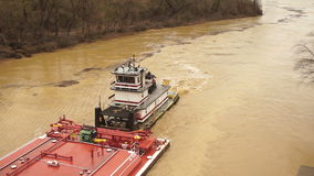 Tugboat Pushes Barge Up Licking River Nautical Transport Vessel. The Licking River over flood stage heading into Newport stock footage