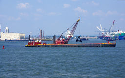 Tugboat pushing dredging barge Royalty Free Stock Photos