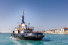 Tugboat. A tugboat ready to push or tow a cruise ship in Venice royalty free stock photography
