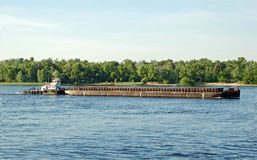 Tugboat and river barge Stock Photo