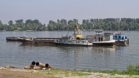Tugboat River Barge. Tug Boat and Barges Construction Platform at Danube River royalty free stock photo