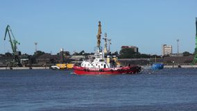 Tugboat sailing in the harbor stock footage
