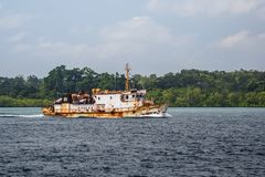 The tugboat sails on the sea. Royalty Free Stock Image