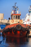 Tugboat ship is in the harbor of seaport Royalty Free Stock Image