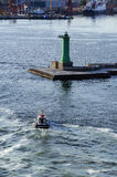 Tugboat ship and lighthouse Royalty Free Stock Image