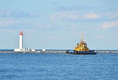 Tugboat ship and lighthouse Stock Photo