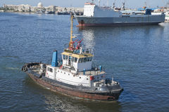 Tugboat on Suez Canal. Tugboat and other shipping on Suez Canal Royalty Free Stock Photos