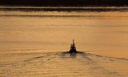 Tugboat Into Sunrise Royalty Free Stock Images