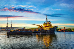 Tugboat at sunrise Stock Photography